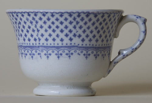 Ermine Border toy tea cup left side