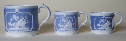 Three Chariot mugs left side