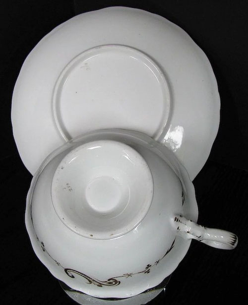 Pattern 3/250 tea cup and saucer backs