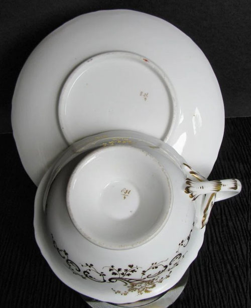 Pattern 4/158 tea cup and saucer bases